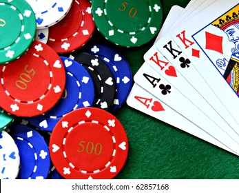 A full house poker hand cards & chips on a green felt table background