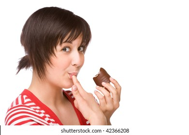 Full isolated portrait of a beautiful caucasian woman eating some sweets