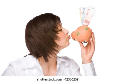Full isolated portrait of a beautiful caucasian woman with a piggy-bank