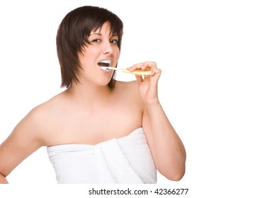 Full isolated portrait of a beautiful caucasian woman with a toothbrush