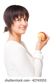 Full isolated portrait of a beautiful caucasian woman with apple