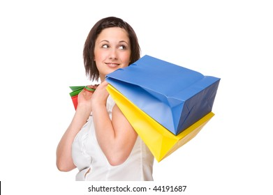 Full isolated portrait of a beautiful caucasian woman with some shopping bags