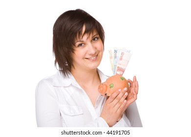 Full isolated portrait of a beautiful caucasian woman with a piggybank