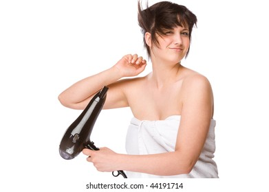 Full isolated portrait of a beautiful caucasian woman with a hairdryer