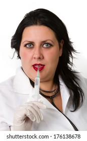 Full isolated studio picture from a young and beautiful doctor  in gloves showing ampule