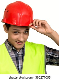Full isolated studio picture from a young construction worker in high visibility vest and protective helmet