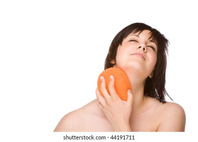 Full isolated studio picture from a young woman cleaning her body