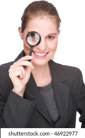Full isolated studio picture from a young and beautiful business woman with magnifier glass
