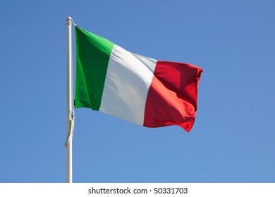 Full Italy flag on a blue sky