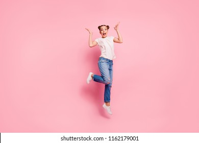 Full legs, body, size portrait of delight of a beautiful girl with dark hair isolated on vivid pink background jumping up from happiness