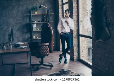 Full legs body size portrait of handsome attractive nice-looking man in formal wear stand near window and comfort chair in bright light interior