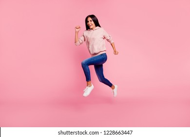 Full legs body size portrait of beautiful attractive adorable good-dressed lady with her brunet hair she run away in street urban wear isolated on pastel pink background