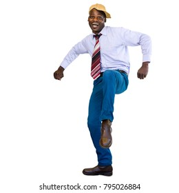 Full length action portrait of happy dancing african businessman isolated.Isolated on white background.