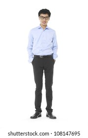 Full length of Asian business man standing with hands on hips over white background