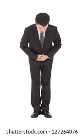 full length of asian businessman with bow and kindly gesture