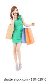 full length of asian woman with shopping bags talking on the phone