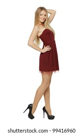 Full length of attractive young female in mini dress posing on white background