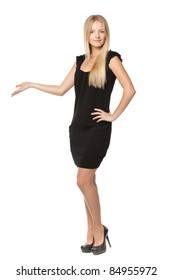 Full length of beautiful blond business woman in black dress showing copy space over white background