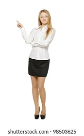 Full length of beautiful blond business woman pointing at copy space over white background