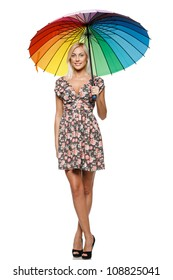 Full length of beautiful blond female in summer dress standing under umbrella over white background