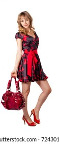 Full length beautiful fashion woman  with bag posing