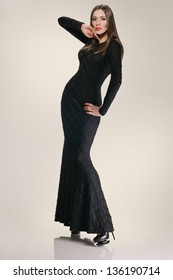 full length beautiful girl in the dress on the studio background