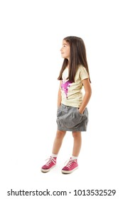 Full length of a beautiful youth girl looking on copy space. Isolated on white background