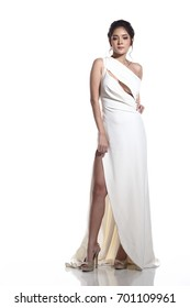 Full Length body, Evening Gown Ball Dress in Asian beautiful woman with fashion make up black hair, High Heel shoes, studio lighting white background isolated copy space.
