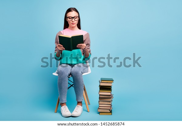 Full length body photo of focused concentrated lady in eyeglasses specs holding thick paper book in hands isolated bright background