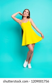 Full length body size of nice cute positive stylish attractive charming straight-haired girl, posing in short dress, isolated on green turquoise background