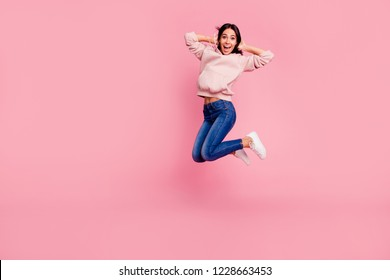 Full length body size of nice cool crazy lovely attractive adorable charming pretty cheerful cheery girl jumping up chill out having fun isolated over pastel pink background