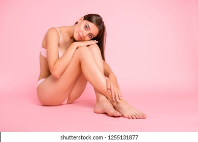Full length body size photo of sitting on floor tender gorgeous attractive tempting she her girl with groomed feet foot hands with great figure shape in pale pink bra isolated on rose background