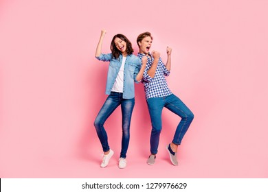 Full length body size photo of two dance floor she her he him his pair yelling favorite soundtrack song best time wear casual jeans denim shirts plaid shirts isolated on rose background