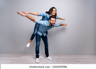Full length body size photo funky cheer she her he him his lady guy piggyback ride walk highway meeting adventures wear casual jeans denim shirts outfit clothes isolated light grey background