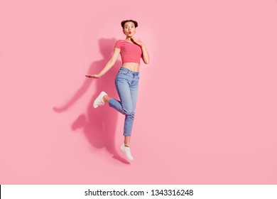 Full length body size photo yelling beautiful she her lady bright pomade lips jump high unbelievable breaking news wear casual jeans denim striped red white t-shirt sit floor isolated pink background