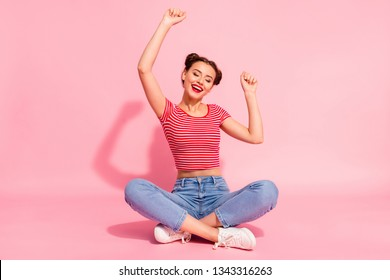 Full length body size photo beautiful she her lady buns pomade lips hands arms up air eyes closed cheerleader wear casual jeans denim striped red white t-shirt sit floor isolated pink background