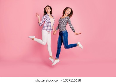 Full length body size photo of funny funky hipsters holding hands having stroll walk fooling laughing feel rejoice dressed modern outfit on pastel background isolated
