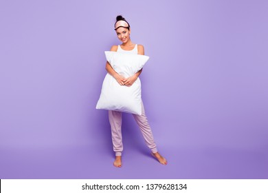 Full length body size photo beautiful she her lady hold arms hands large big pillow naked nude feet foot satisfied wear sleeping mask pastel pants tank-top pajamas isolated violet purple background