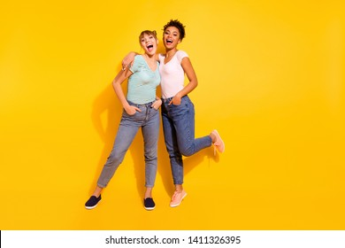 Full length body size photo beautiful she her lady laugh laughter buddies fellows different nationalities hands arms pockets wear casual white striped t-shirt clothes isolated yellow bright background