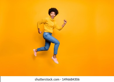 Full length body size photo of running pretty funny girlfriend cute black skinned wearing jeans denim pullover aspiring for sales discounts isolated vivid color background
