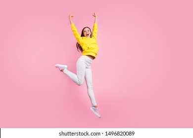 Full length body size photo of cute charming nice pretty sweet girlfriend having reached finish line first raising hands up wearing yellow sweater isolated over pink pastel color background