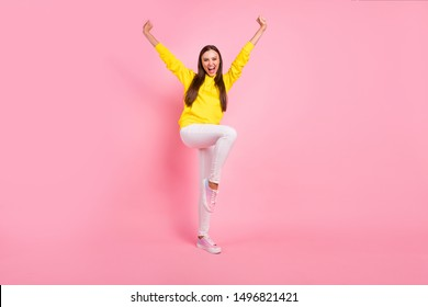 Full length body size photo of charming cute attractive nice pretty sweet lovely girlfriend raising her leg like jumping rejoicing with sales wearing yellow hoodie isolated with color background