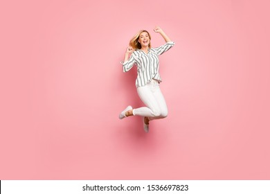 Full length body size photo of charming crazy ecstatic overjoyed woman wearing trousers pants jumping up isolated pastel color background