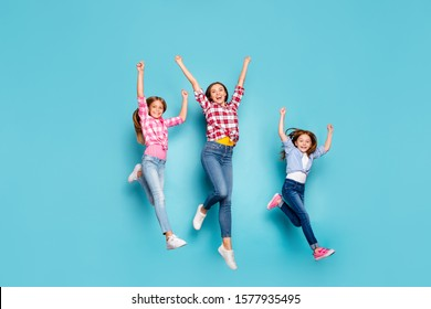 Full length body size photo of cheerful friendly white family enjoying pin-up winning running competitions while isolated with blue background wearing jeans denim