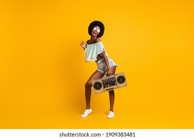 Full length body size photo of black skinned girl cassette recorder listening music enjoying party isolated on bright yellow color background