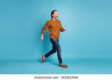 Full length body size photo middle-aged bearded man smiling stepping hurrying in stylish clothes isolated on bright blue color background