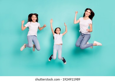 Full length body size photo funky cool sisters jumping up won lottery keeping hands up isolated vibrant blue color background