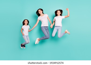 Full length body size photo sisters jumping up wearing casual outfits happy overjoyed cheerful isolated vivid blue color background