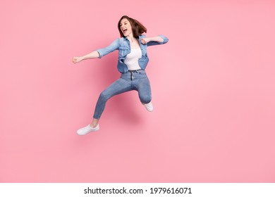 Full length body size photo girl jumping practising karate looking copyspace isolated pastel pink color background