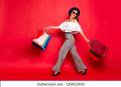 Full length body size portrait of careless carefree trendy stylish elegant chic lady wearing eyeglasses eyewear off-the-shoulders blouse top high heels shoes isolated on red background